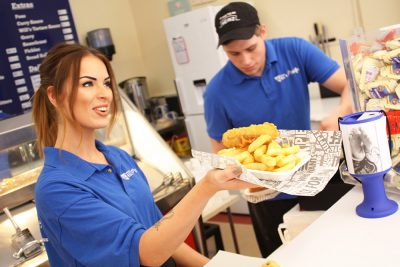 Will's Plaice staff serving Fish n Chips.