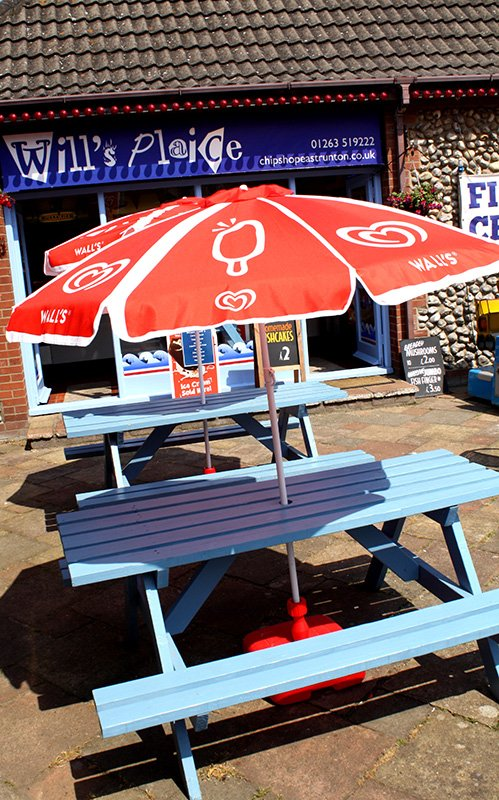 Tables and umbrellas outside Will's Plaice.